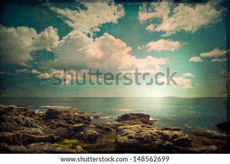 ocean and rocky coast in retro...
