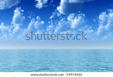 Ocean and sky with fluffy clouds
