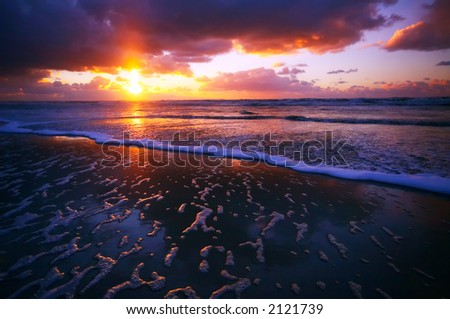 Ocean and sunset on the beach at night