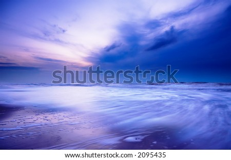 Ocean at night (taken with a slow shutterspeed) - stock photo