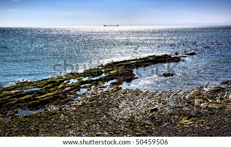 Ocean Bank and Boat Outline in Background ofQuebec,Canada - stock ...