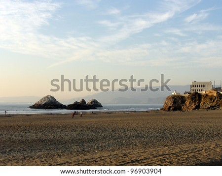 Ocean Beach at dusk with the Cliff House and Seal Rock in San Francisco, California