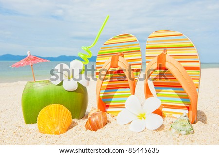 Ocean beach with palms and and coctail