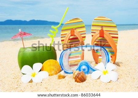 Ocean beach with palms and and coctail - stock photo