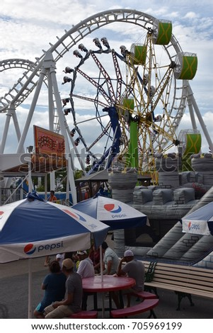 OCEAN CITY, MARYLAND - JUL 1: Trimpers Rides in Ocean City, Maryland, on July 1, 2017. The city It features miles of beach and a wooden boardwalk lined with restaurants, shops and hotels. #705969199