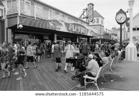 Ocean City, Maryland / United States of America - August 11, 2018: Black and white photograph on the boardwalk in Ocean City Maryland