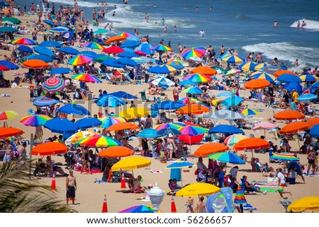 OCEAN CITY, MD - JUNE 25: View on the beach. Ocean City is a well known family resort located on the East Coast in Maryland state. Famous of Crabs and Beaches June 25, 2010 in Ocean City, MD. - stock photo