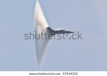 OCEAN CITY, USA - JUNE 12:F-18 Super Hornet travels subsonic speed with visible Vapor Cone on June 12, 2011 in Ocean City, MD, USA. Vapor Cone is also called Sonic Boom and is a very rare observed