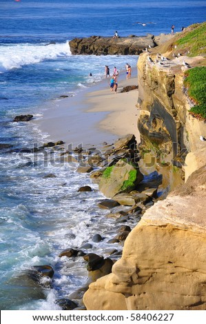 Ocean cliffs and people on the beach.