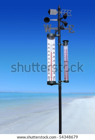 ocean coast at summer sunny day and thermometer