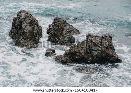 Ocean Crashing against Shoreline Rocks