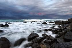 Ocean crashing over rocks at Burleigh Heads, Gold Coast, Australia
