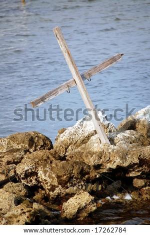 Ocean cross on jetty