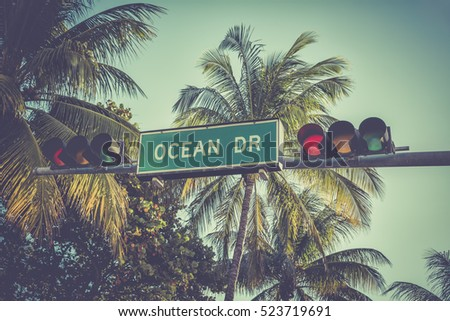 ocean drive sign with palm...