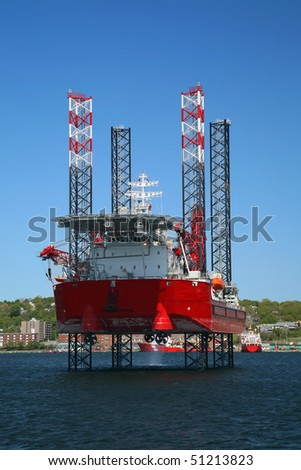 Ocean going oil rig in Halifax Harbor, Nova Scotia, Canada.  Dartmouth can be seen along the shoreline.