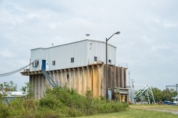Ocean Harvest Ice House, a tall metal building that provides supplies for local shrimp boats, at Bayou Carlin dock, along the Delcambre Canal in South Louisiana.