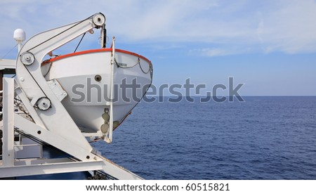 ocean landscape from cruise ship with lifeboat