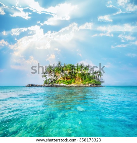 Ocean landscape with palm trees at tropical island under blue sky. Thailand travel landscapes and destinations #358173323