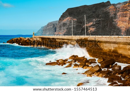 Ocean on a summer day and spray of waves. Seaside resort.