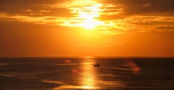 Ocean sunset with boats in sea. Mumbai, India