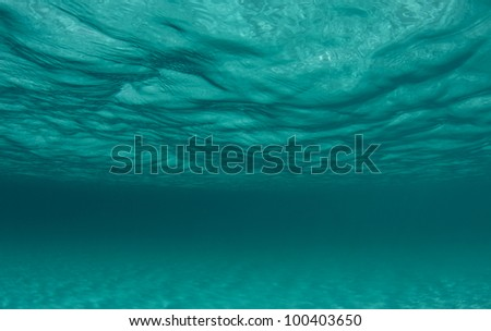 ocean surface and the sand below