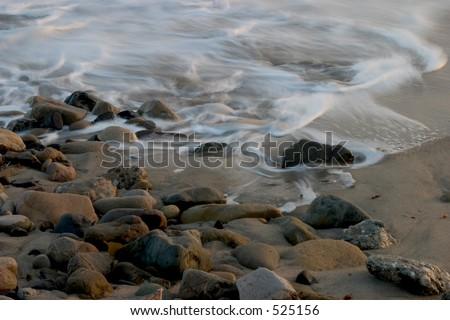 Ocean Tide Coming in over Rocks