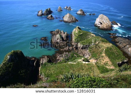 Ocean view over rugged rocks at the Nugget Point. South Island. New Zealand