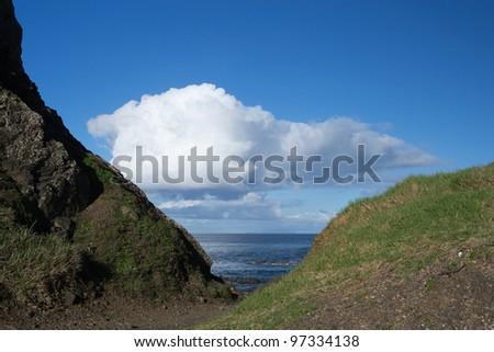 Ocean View through a Gap in Hills