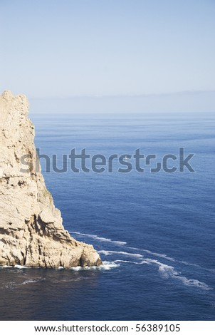 Ocean view with rocks and lonely boat