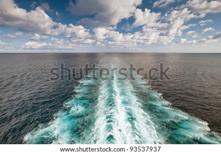Ocean view with wake trace of cruise ship