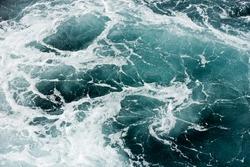 Ocean wave background. Bubble water foam backdrop. Turbulent sea texture. Messy water flow.