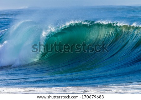 Ocean Wave Curl  Clean ocean wave rolling curling lip crashing on shallow sandbars. #170679683