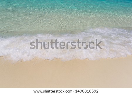 Ocean wave on a tropical paradise sandy beach. Beautiful surface texture, travel landscape clean white sand and blue turquoise sea water, wave ripple in beautiful ocean and natural sandy island. #1490818592