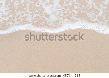 Ocean wave on sandy beach for background use #457144915