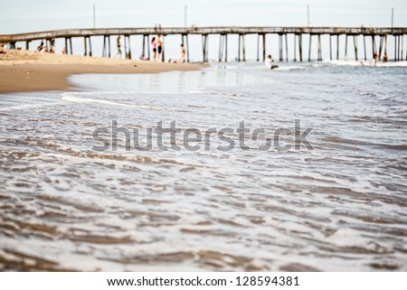 Ocean waves coming in at the pier at Virginia Beach