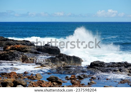 Ocean waves crashing on rocks, Kauai, Hawaii