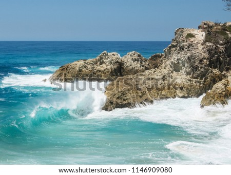 Ocean waves over the Point Lookout Gorge rocks during a king tide ion a beautiful summer day 2018. North Stradbroke Island, Queensland.  stock photo