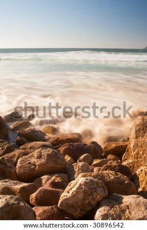 Ocean waves splashing on rocks