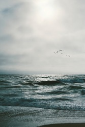 Ocean waves with gray skies and copy space