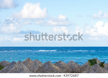 Ocean with gazebos and palapas