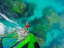 Ocean world of windsurfing over coral reef