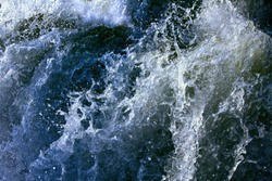 Oceanic waves during storm. Water roll forward and boils at shore. Tidal bore broke in ugly sea.