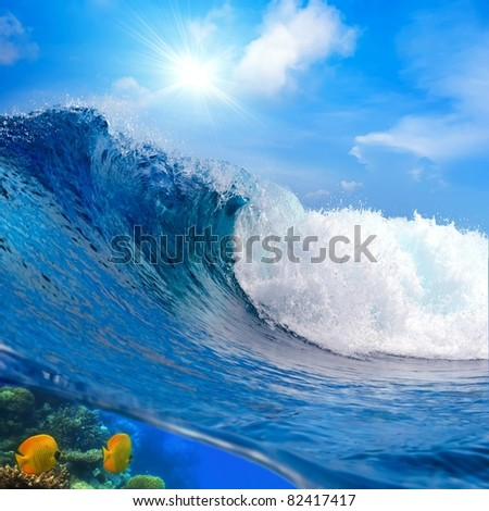 oceanview big surfing breaking ocean wave cloudy sky and the sunlight - stock photo