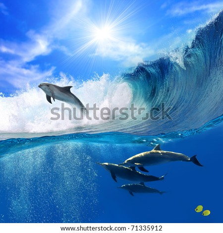 Oceanview with sunlight A flock of playful dolphins swimming underwater and one of them leaping out from big sea surfing wave
