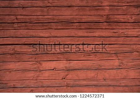 Ocher red wooden wall of old Swedish cabbin