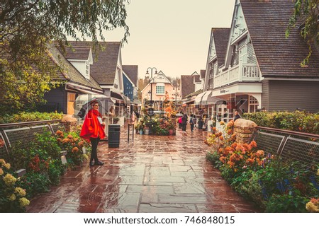 Oct 26,2017 - Bicester Village, London : Inner view of Bicester Village outlet at a rainy day #746848015