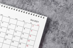 October Calendar 2021 on wooden table background.