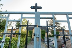 October 2021. Italy. Closed gate of a cemetery.