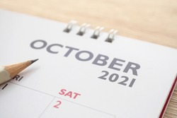 October month on 2021 calendar page with pencil business planning appointment meeting concept
