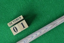 October 1, Number cube With a snooker stick on a green background, snooker table.